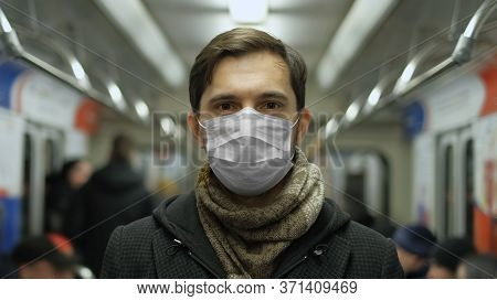 Man In Face Mask For Covid-19. Subway Station. Corona Virus. Epidemic Coronavirus Mers. Pandemic Flu