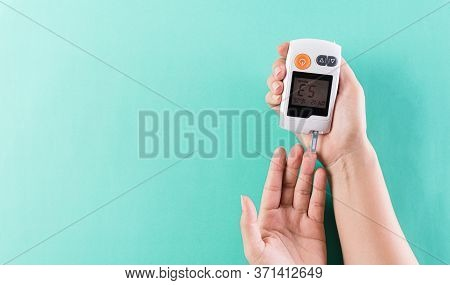Healthcare And Medical Concept, The Diabetic Measures The Level Of Glucose In The Blood. World Diabe