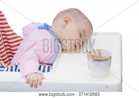 Babys Sleep While Eating On The Table Glass With Food