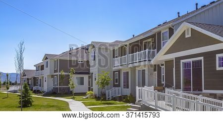 Scenic Residential Neighborhood In Daybreak Utah With Mountain And Sky View
