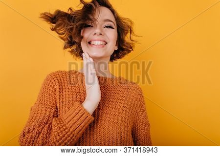 Indoor Portrait Of Easygoing Young Woman Expressing Happiness. Studio Shot Of Brown-haired Positive