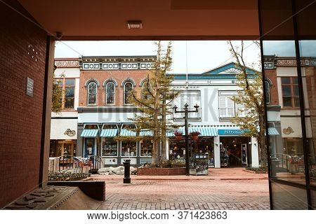Boulder, Colorado - May 27th, 2020:  Small Businesses Seen Through A Corridor At Pearl Street Mall I