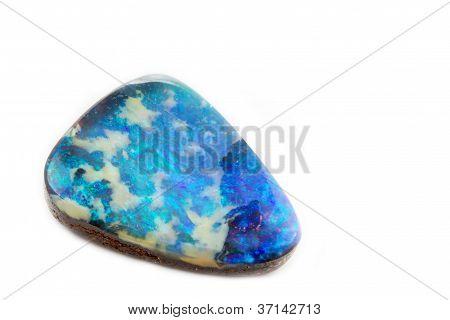 Single opal jewel arranged on white background poster