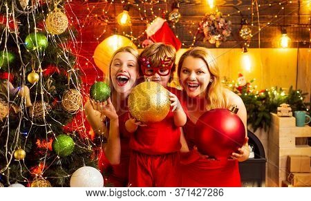 Happy Crazy Trio At Christmas Decorated Amazing Background. Present Box. Family Winter Holidays And