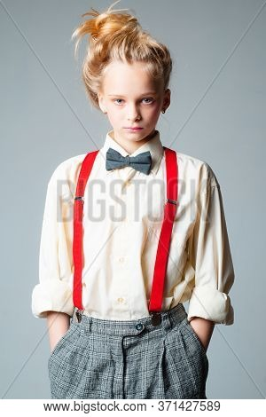 Teen Girl In Retro Male Suit. Retro Fashion Model. Vintage Charleston Party. Jazz Step Fashion. Susp