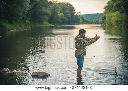 Fisher Fishing Equipment. Handsome Man Relaxing. Leisure On Lake. Set Up Rod With Hook Line Sinker.