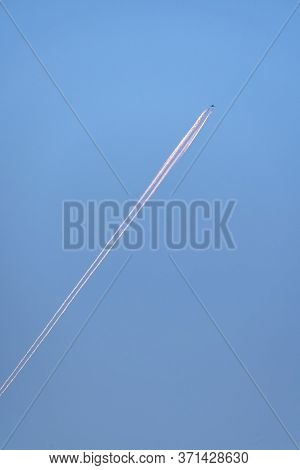 Diagonal Contrail Behind A Climbing Airplane Day Light