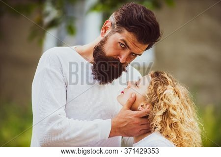 Sexy Initiative Woman With Young Aroused Man. Kiss Each Other Teasing Enjoying Tenderness And Intima