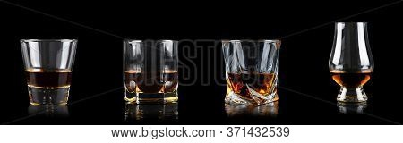 Set Of Four Glass Of Whiskey Or Other Alcohol On Black Background