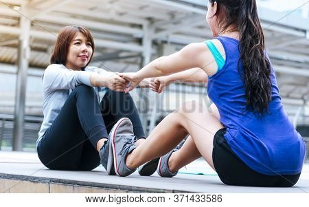 Sport Fitness Woman Stretching Body Exercise In Modern City Wear Wellness Sportswear Outside. Young