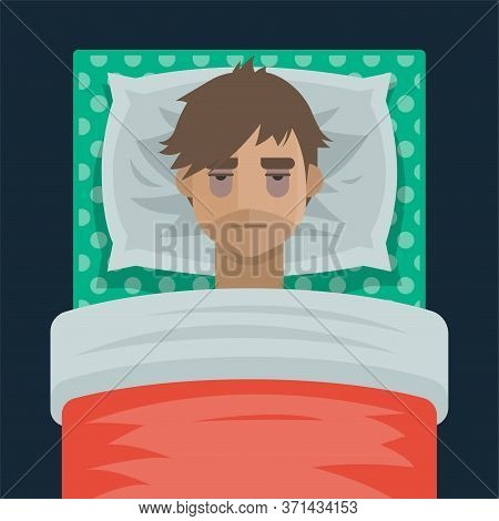 Young Man With Sleep Insomnia Problem. Man Try To Sleep On Pillow In His Bed Under The Blanket. Exha