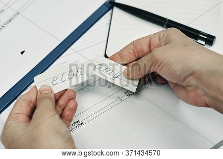 Man Tearing Paper With Word - Economy. Concepts Of Economic Crisis, Economy Breakdown, Economic Coll