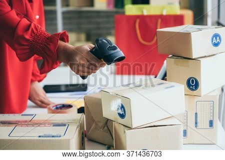 Online Seller Works At Home Office And Packs Shipping Delivery Box To Customer.