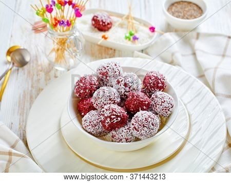 No-bake Berry Bliss Balls With Desiccated Coconut And Chia Seeds Mixed With Peanut Butter And Raspbe