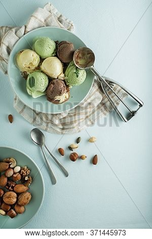 Set Of Soft Ice Cream Scoops Of Different Flavours With Chocolate And Nuts