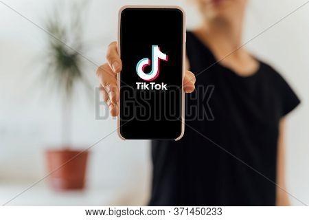 Poltava, Ukraine - May 2020 Tiktok App On Phone Screen In Girl Hands