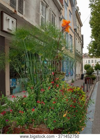 Troyes, France - August 31, 2018: A Beautiful, Colorful Flower Bed In Front Of The Facade Of The Tro