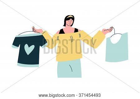 Young Woman Choosing Between Two T-shirts During Shopping