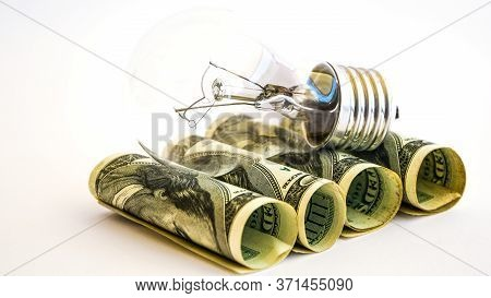 Money Saved In Different Kinds Of Light Bulbs, Lamps On The Usd American Dollar Background, Energy S