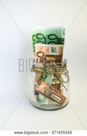 Glass Jars Filled With Coins And Euro Bills, Savings Inside Glass Jar, Money Isolated On White, Copy