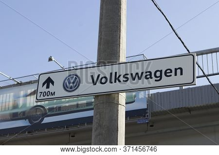 Volkswagen Lettering On A Road Sign Indicating The Distance To A Service Center Or Official Dealer B