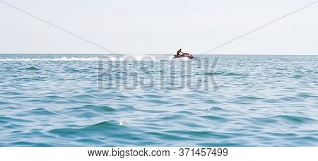 Young Guy Cruising On A Jet Ski On The Sea