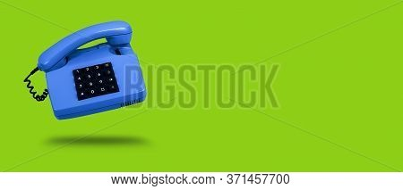 Vivid Blue Old Landline Phone On Green Background. Banner. Copy Space. Hotline Phone, Call Center, C