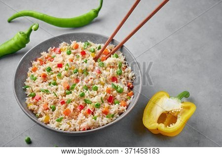 Veg Fried Rice In Gray Bowl On Concrete Table Top. Veg Fried Rice Is Indo Chinese Cuisine Dish. Indi