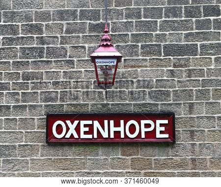 Oxenhope, England - June 24:  A Destination Sign And Traditional Lantern At Oxenhope Station On The