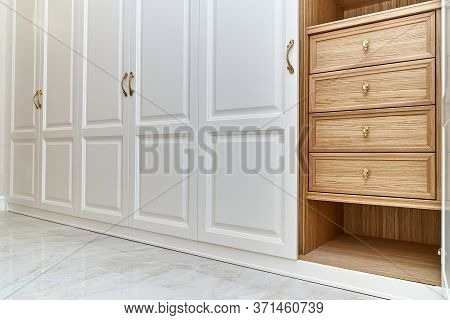 White Wardrobe With Wooden Drawers And Shelves. Wooden Filling Of Wardrobe