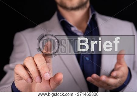 Businessman Presses A Button Finger With The Text Brief. Business Concept.