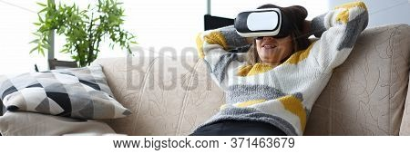 Girl Sits Sofa Home Relaxes With Virtual Glasses. World Transmitted To Man Through His Sensations Si