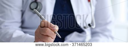 Experienced Doctor In White Coat Takes Notes. Analysis Relationship Between Risk And Benefit. Examin