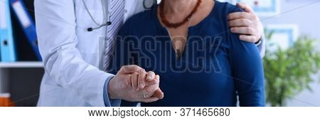 Male Doctor Hugged Elderly Lady Helping To Go Out. Social Isolation Elderly. Multiplicity Disorders