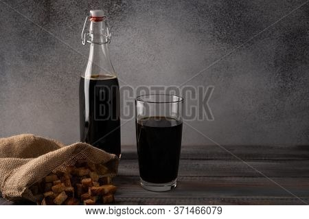 Homemade Tradishional Russian Kvass With Glass Cup And Crackers In A Bag. Wonderful Healthy Refreshi