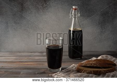 Homemade Tradishional Russian Kvass With Glass Cup And Bread. Wonderful Healthy Refreshing Drink For