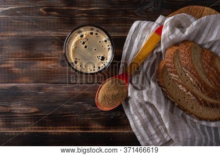 Top View Homemade Tradishional Russian Kvass In Glass With Foam And Bread On Napkin. Wonderful Healt