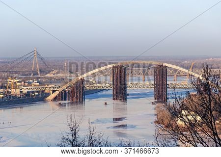 Metro-automobile Tied Arch Bridge With Arch-shaped Superstructure Over Winter River During Construct