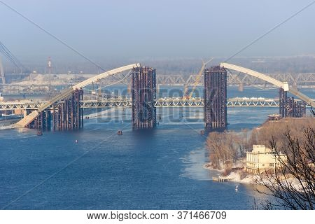 Metro-automobile Tied Arch Bridge With Arch-shaped Superstructure Over River During Construction. Po