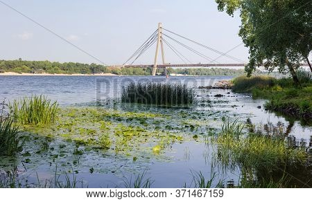 Modern Road Cable-stayed Bridge Over River With One Pylon And Steel Cables Of Semi-fan Design. Pivni