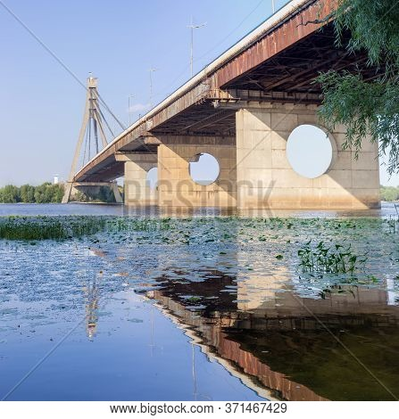 Modern Road Cable-stayed Bridge Over River With Concrete Pylon And Steel Cables, Bottom View From Th