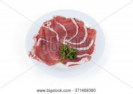 Uncooked Tenderized Boneless Slices Of Pork Loin For Chops Preparation On The Dish On A White Backgr