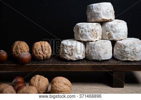 French Cheese Crottin De Chavignol With Hazelnuts And Walnuts In The Dark Background. High Quality P