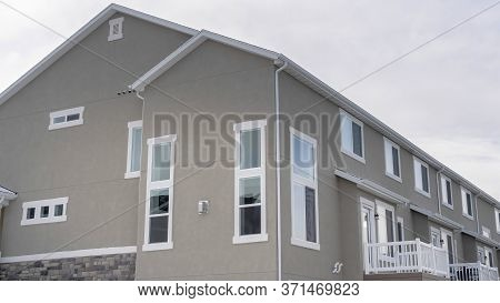 Panorama Townhouses Exterior With Small Balconies At The Facade In South Jordan Utah