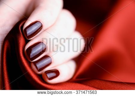 Manicure With Burgundy Color Nails On Burgundy