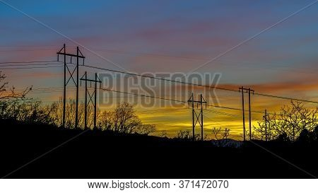 Panorama Crop Electricity Posts Silhouetted Against Blue Sky In Provo Canyon Utah At Sunset