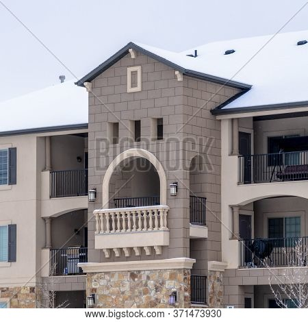 Square Frame Beautiful Apartment With Front Gable Roof And Arched Balcony Viewed In Winter
