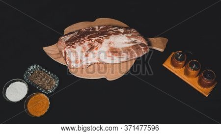 Sliced Meat On A Black Background. Marinated Pork With Close Up Before Cooking Kebabs.