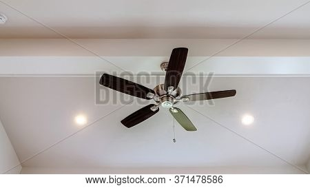 Panorama Ceiling Fan With Wood Blades And Built In Lights On The Ceiling Beam Of Home