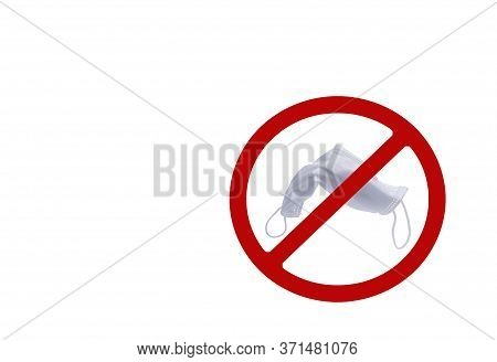 Used White Surgical Face Mask In Red Forbidden Symbol On White Background. No Discard Used Medical F